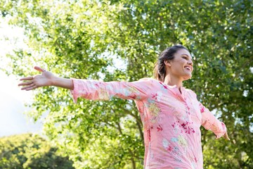 Pretty brunette feeling free in the park