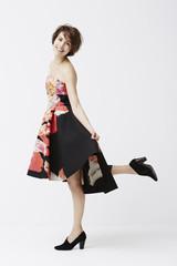 Glamorous woman posing in dress