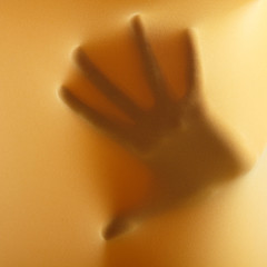 abstract hands, human arm inside yellow fabric, studio shot