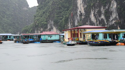 Floating Fishing Village from Boats POV - Ha Long Bay Vietnam