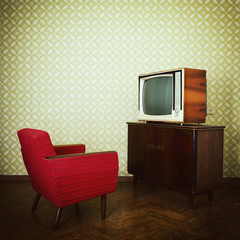 Vintage room with two old fashioned armchair and retro tvover ob
