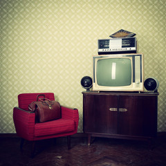 Vintage room with wallpaper, old fashioned armchair, retro tv, b