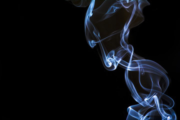 Blue smoke from a candlelight close up.