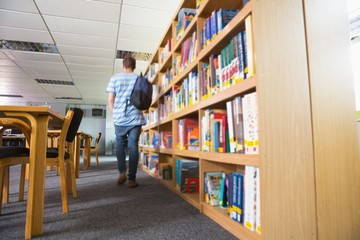 Student walking away in the library