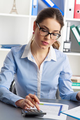 Audit woman concept. Businessperson calculating annual budget