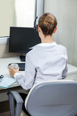 Female Customer Service Agent Working At Desk