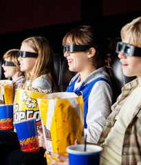 Siblings Watching 3D Movie In Cinema Theater