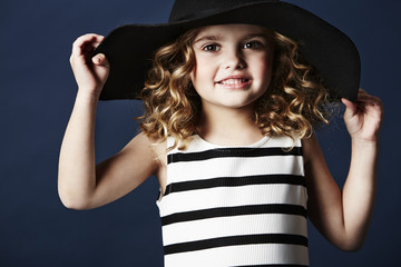 Fashionable girl posing in hat