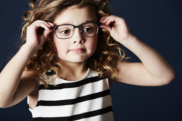 Girl in spectacles posing