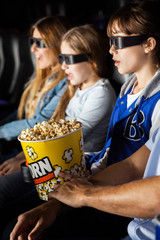 Family Enjoying 3D Movie In Theater