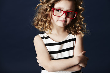 Girl thinking in spectacles