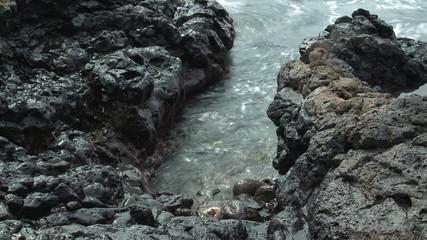 Waves on Lava Rocks