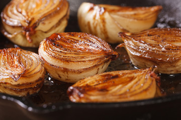 сaramelized onion halves with balsamic vinegar in a pan