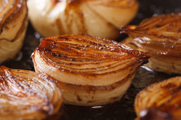 сaramelized onion halves with balsamic vinegar in a pan macro