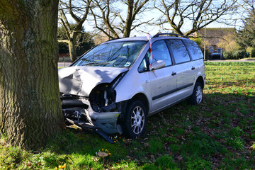 A head on car crash into a tree in Horley, Surrey in winter.