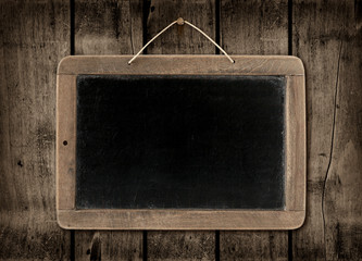 Blackboard on a dark wood wall background