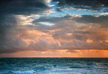 Dark colorful sunrise sky over Atlantic ocean