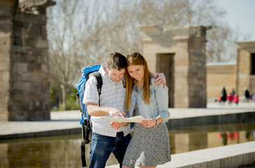 American student tourist couple reading city map in tourism