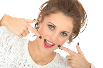 Happy Young Woman Pointing to Teeth