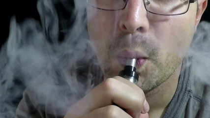 Man Exhaling smoke from a vaporizer 120 FPS Four