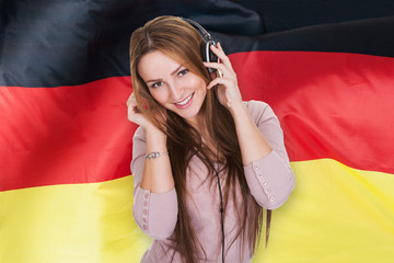 Woman Listening German Learning Audiobook