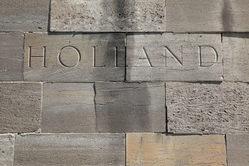 Holland. Word carved into the stone blocks.