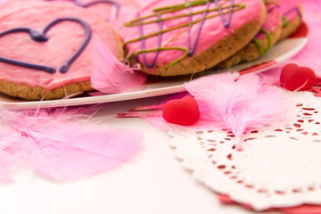 Valentines Day - decorations and cookies with pink frosting and