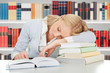 Female Student Sleeping In A Library