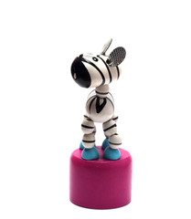 small wooden toy zebra on a pedestal