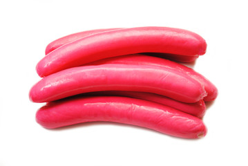 Stacked Raw Red Hotdogs Over White