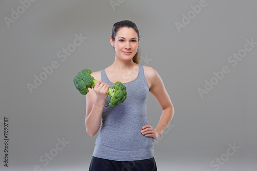 canvas print picture Arm exercise with broccoli dumbbell