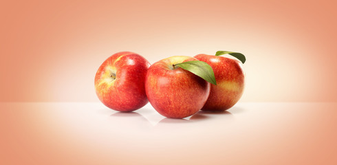 yellow red apples isolated on a colored background