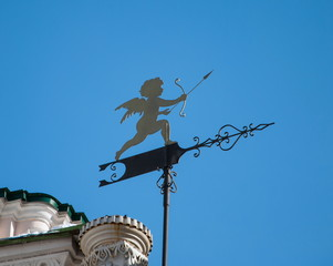 Weather vane in the form of cupid with arrow