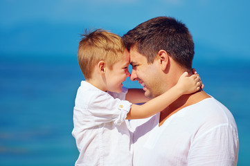 cute father and son embracing, family relationship
