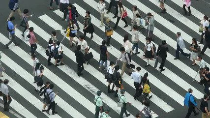 Busy Pedestrian Street Crossing From Above  - Shibuya, Tokyo Japan