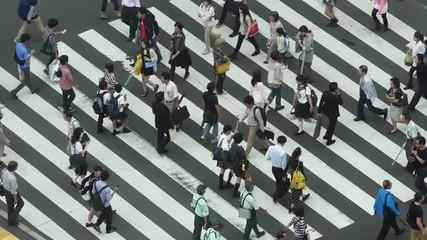 Busy Pedestrian Street Crossing From Above  - Shibuya, Tokyo Japan