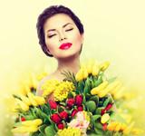 Fototapety Beauty model woman with spring flower bouquet