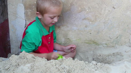 boy plays sand