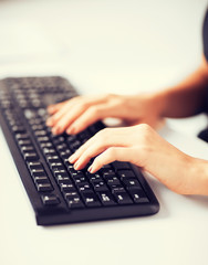 woman hands typing on keyboard