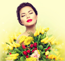 Beauty model woman with spring flower bouquet