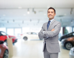 happy man at auto show or car salon