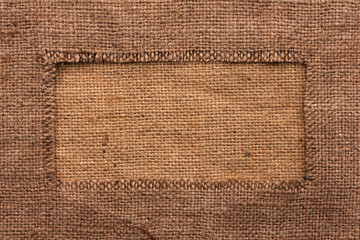 Frame of burlap, lies on a background of burlap
