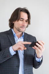 man with a smartphone in the hands of