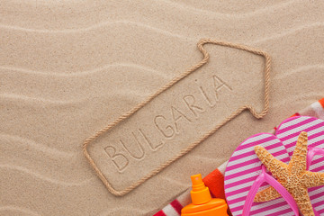 Bulgaria  pointer and beach accessories lying on the sand