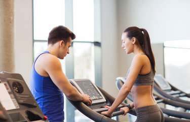 woman with trainer on treadmill in gym