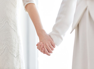 close up of happy married lesbian couple hugging