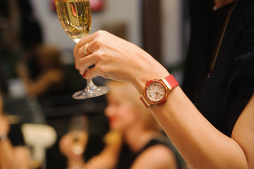 Toasting and celebrating to success with a flute of champagne