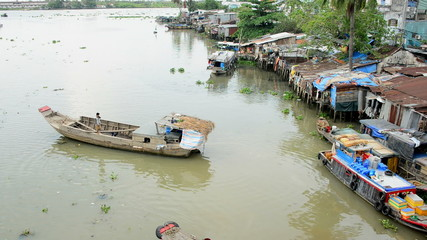 Zoom Out of House Boats and Shacks on the Saigon River - Ho Chi Minh City (Saigon)