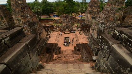 Zoom Out - Looking Down Temple Steps as Tourists walk around the Altar - Angkor Wat, Cambodia