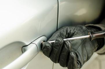 Burgler braking into car